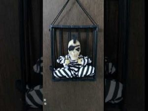 Cage One Eye Scary Skeleton Musical Hanging Halloween Toy